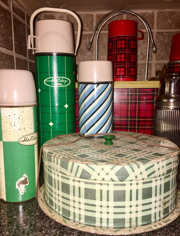 Vintage plaid tin cake carrier with vintage thermoses