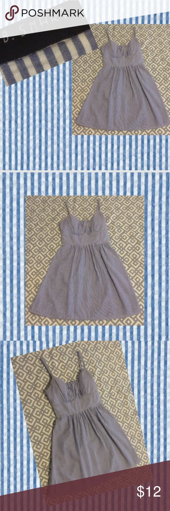 """B. Smart, M seersucker blue & white dress Padded built in bra in the top w/adjustable straps. Dress zips up in the back. Dress is blue & white seersucker; fully lined. Waist is 28"""", bust is 36"""", and length is 26"""" (as measured from below the armpit to the bottom of the dress). B. Smart Dresses"""