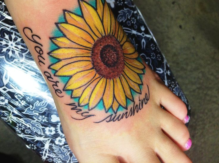 "Sunflower foot tattoo with script ""You are my sunshine"" #foottattoo #tattoos #sunflower #script #love"