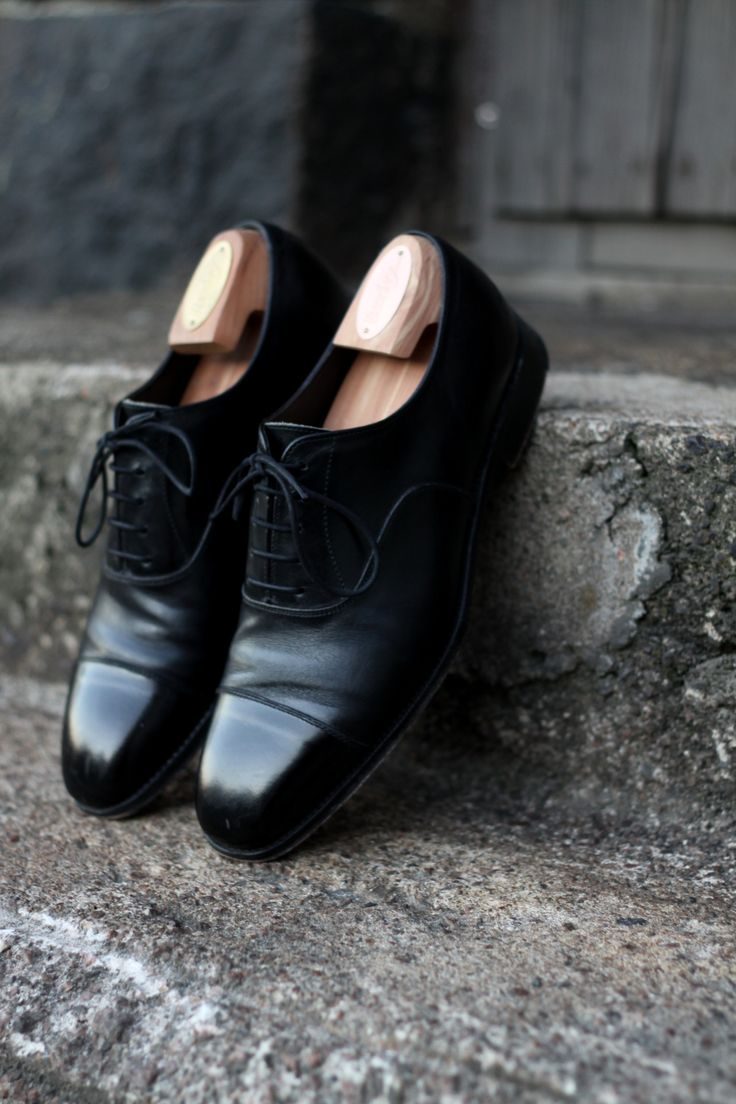 Black cap-toe oxfords by Alfred Sargent