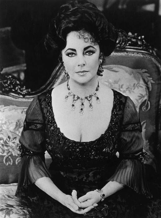 "Elizabeth Taylor - Performing in a production of ""The Little Foxes"" at the Los Angeles Music Center, c. 1982 / Preparing to shoot a scene for a movie at the Queen Mary, c. 1981"