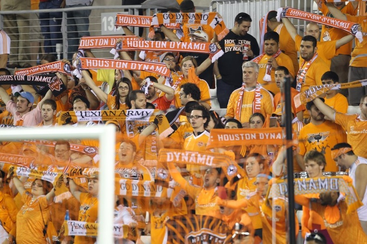 TA holding the scarfs up as players come on the pitch for the second halfSecond Half, Houston Dynamo, Ta Holding