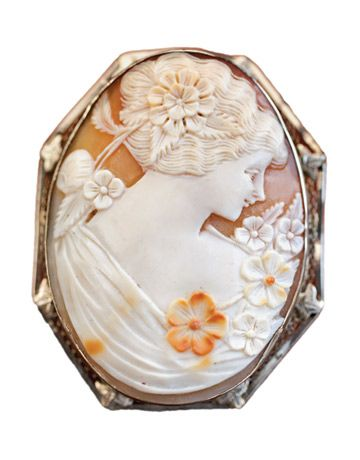 White-Gold Cameo Pin This intricately carved white-gold cameo pin was spied among the estate jewelry for sale at Dianne Milk Antiques.