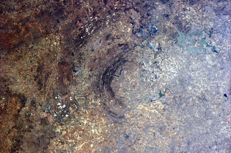 This happens when a cosmic companion hits us. See city top right for scale... Vredefort crater in SouthAfrica. Picture: Astronaut Alexander Gerst