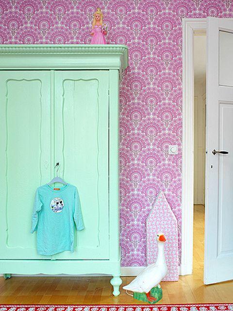 Aqua armoire and wallpaper.