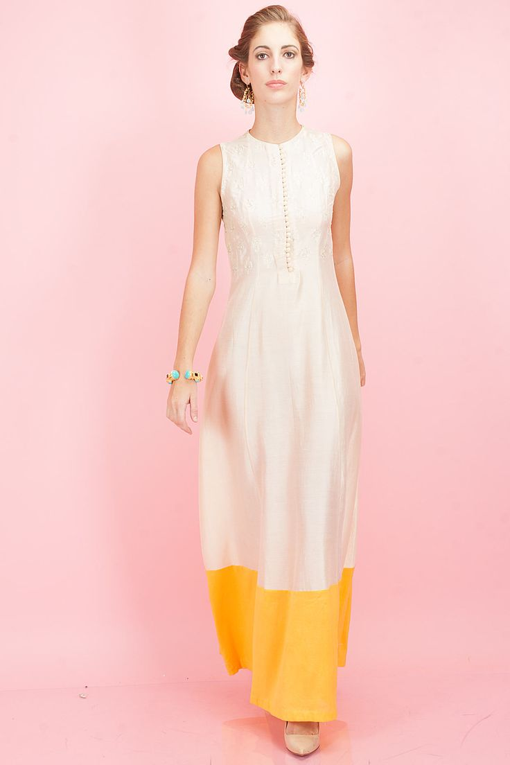 Beige floor length tunic with yellow border available only at Pernia's Pop-Up Shop.