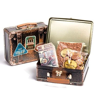 Heritage Suitcase Hamper Tin  Milk Speckles, Honeycomb Block and Teddy Puzzle pack in a heritage suitcase hamper tin.