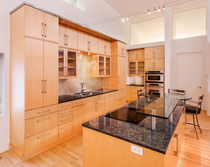 The Seamless Cabinetry Giving All Shining Glory To Black Galaxy Granite And Stainless Steel Backsplash Photo Source Design Connection Inc