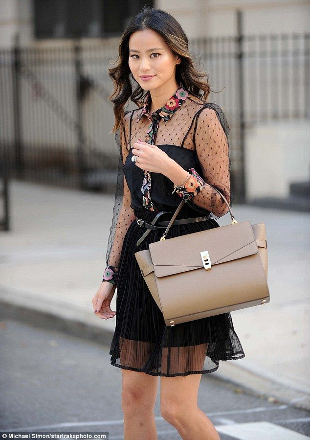 Chic carryall: Jamie Chung, 33, is the latest celeb to be spotted with Henri Bendel's stylish 'Uptown Satchel'