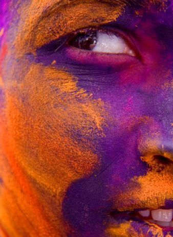 The beauty of colour here - not sure if I would go as far as immersing myself with colour on my face but love the purple and orange together.