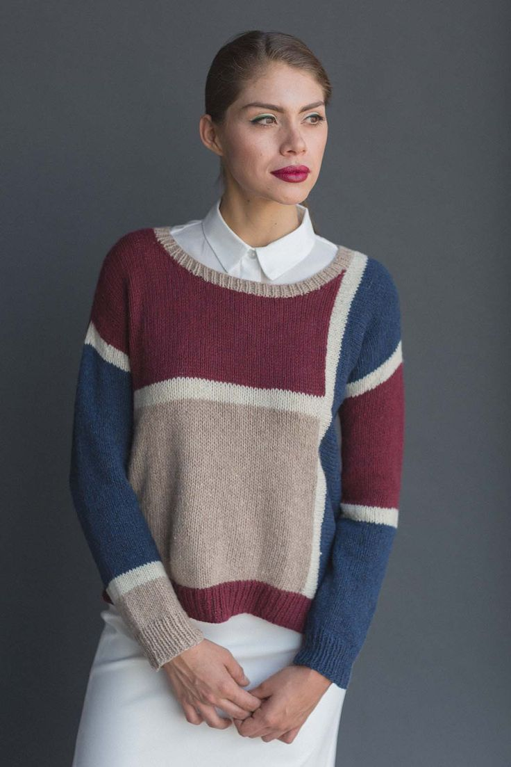 Explore modular knitting and asymmetry with Lana Jois's Slide Pullover from knitscene Summer 2018. The drop sleeves and scoop neck make for easy knitting and a casual look, and the multicolor, multidirectional knitting elevates the overall effect of this color-block pullover knitting pattern.