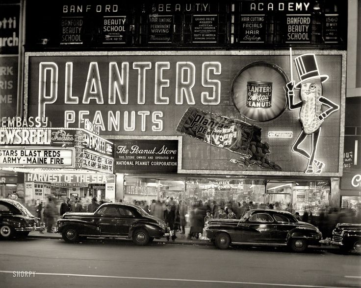 """New York circa 1947. """"National Peanut Corp. store on Broadway -- Mr. Peanut sign and Embassy Newsreel Theatre."""" 4x5 negative by John M. Fox.  Shorpy Historic Picture Archive :: National Peanut: 1947 high-resolution photo"""