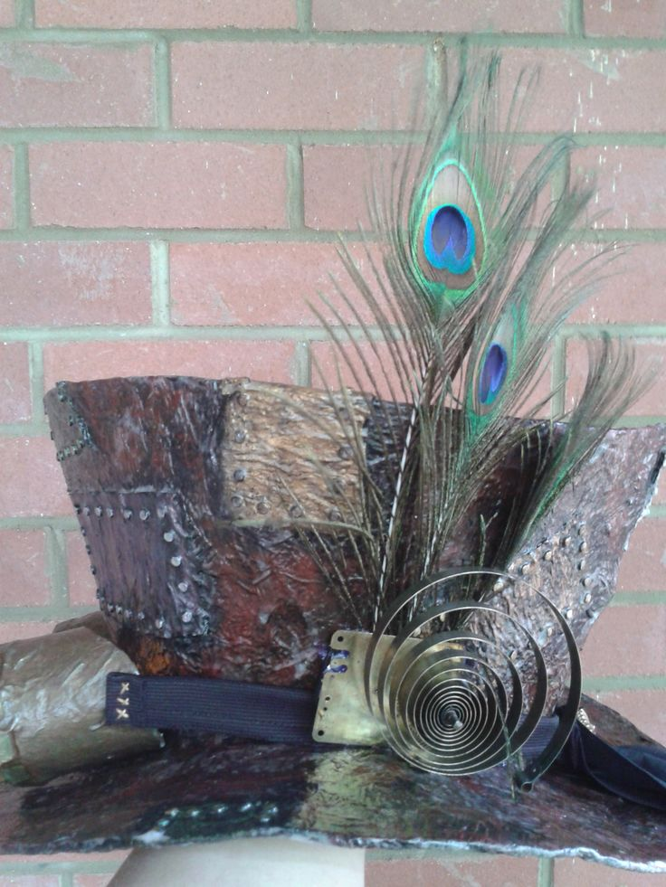 Steampunk Tophat made from recycled cardboard and other bits and pieces. Side view - Old clock spring and peacock feathers!
