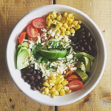 Freshii Pangoa Bowl: brown rice, avocado, aged cheddar, cherry tomatoes, black beans, corn, cilantro, lime wedge, fiery bbq sauc