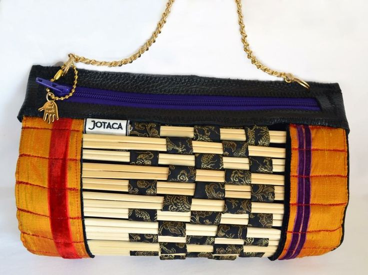 Chopsticks Bag 2014 Made by JOTACA Up cycled from chopsticks, silk, velvet, leather, and chain.