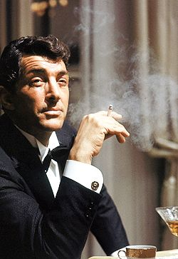 Dean Martin, I loved his movies and singing as a child, I had never seen anyone with such a devil may care attitude on television. I understood later it had something to do with the Martinis. Charisma!
