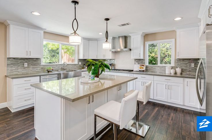 Out with dark woods and deep-toned granites; white and gray make the kitchen of today.