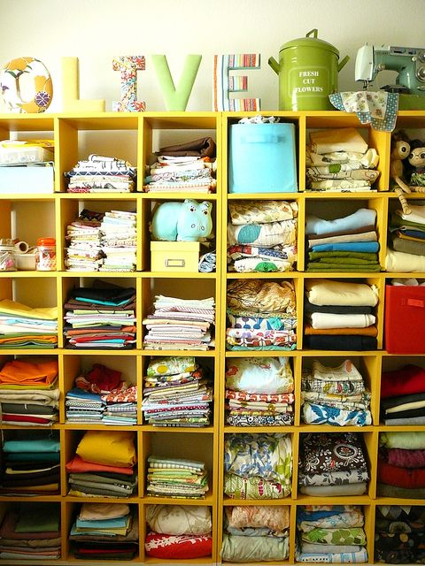 I need cubbies like this for my fabric stash. A fabric bar would be nice to go with it! :)