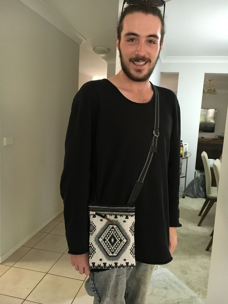 """My nephew, Hayden, wearing the tapestry passport holder I made as a birthday present. This one is in """"black"""" with contrast """"teal"""" colour lining, leather trim, and """"silver"""" metal hardware.  A special security feature is the metal Jean zipper which stays locked when the slider sits flat and flush with zipper."""
