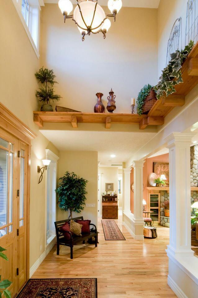 A high ceiling made less intimidating with a decorative ...