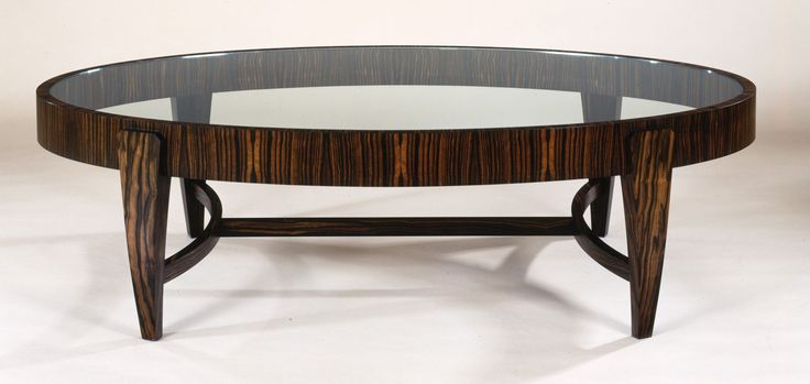 Gorgeous Oval Glass Coffee Table as Contemporary Furniture - http://www.ruchidesigns.com/gorgeous-oval-glass-coffee-table-as-contemporary-furniture/