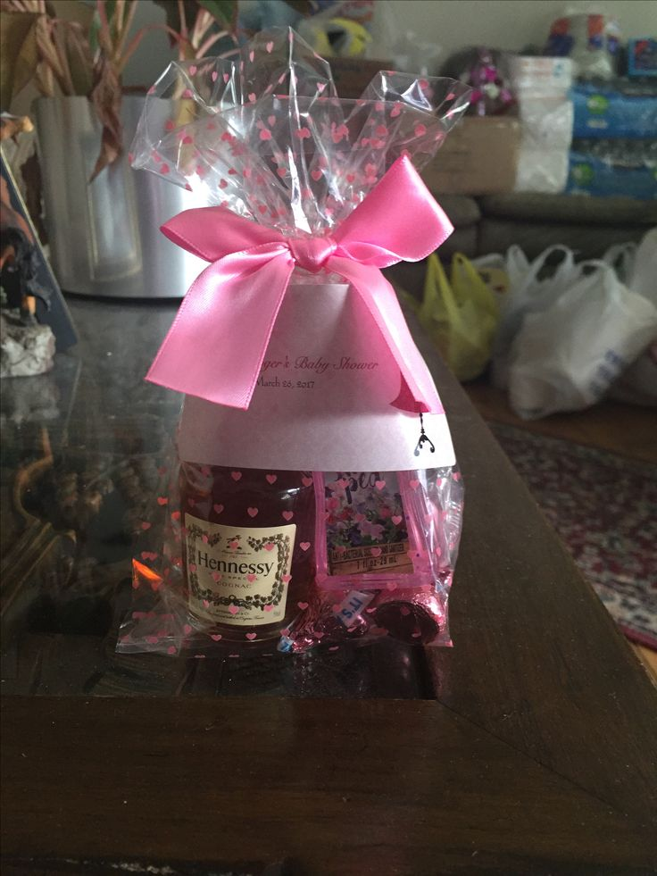 These are gifts that I made for the games I will play at the baby shower.  1 mini bottle of Hennessy  3 pink Hershey kisses  1 coin chocolate  1 hand sanitizer   Labels are made from Vistaprint.com  And the bags are bought from party city.