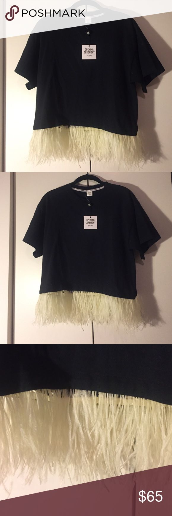 Black t-shirt with detachable feathers Black cotton opening ceremony t-shirt with white detachable feather lining bottom of shirt. New, never worn, with tags! Runs large, fits truly like a small Opening Ceremony Tops Tees - Short Sleeve