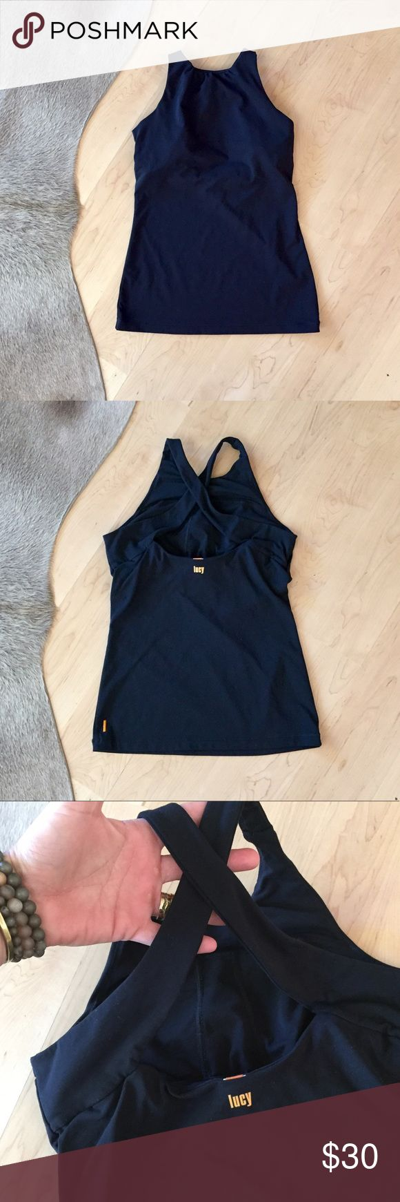Lucy Cross Back Halter Lucy Cross Back Halter athletic top with built in shelf bra (no padding). Super cute. Only worn a few times. Cleaning out my workout wear section of my closet. Lucy Tops Tank Tops