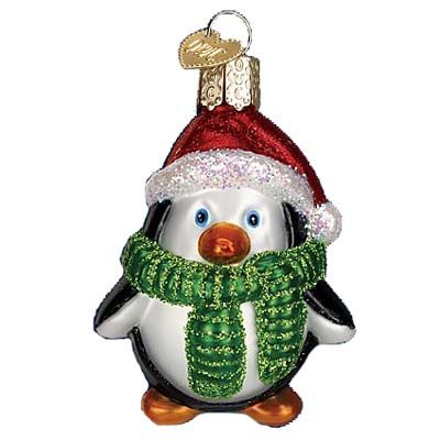 "Playful Penguin Christmas Ornament 16083 Merck Family's Old World Christmas Introduced 2011 Measures approximately 2 3/4"" Mouth blown, hand painted, glass Christmas ornament"