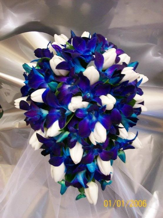 Blue orchid and white tulip bouquet.  Beautiful! I LOOOOVE THIS