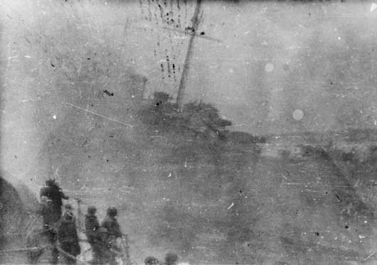 Port bow view of HMAS Canberra sinking, taken from one of the US Navy destroyers in the Battle of Savo Island. The Japanese task force was spotted by reconnaissance aircraft but poor reporting and message handling delays obscured the significance of the intelligence.US Naval history blamed the pilots for not passing on the intelligence but that has recently been proved to be incorrect.