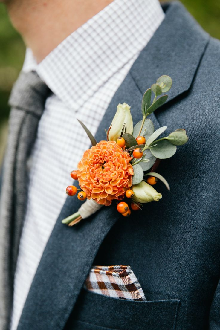 Autumn boutonniere featuring a mini dahlia, rose hips and eucalyptus.  Orange and cream.  Grown and designed by Love 'n Fresh Flowers.  Photo by Emily Wren Photography.