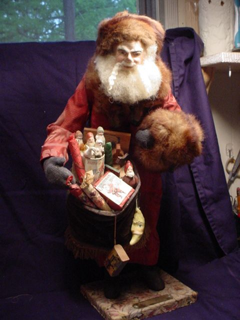 A Santa we did in 1995, Face had breakage, Just repaired it for a friend.  DeCamp he's 21 years old.