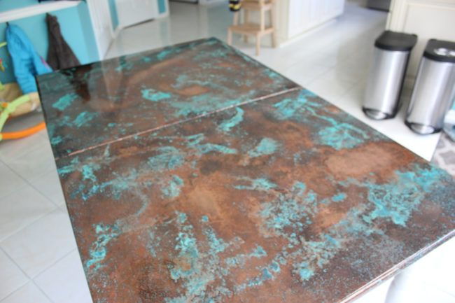 The corroded copper tabletop makes for a strangely attractive design.