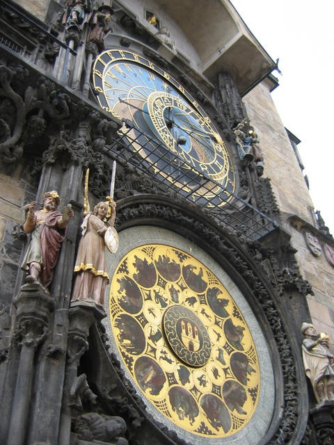 The Prague Astronomical Clock, built in to one side of the Old Town Hall Tower, dates from the 15th century.  To fully appreciate the clock's intricate construction, wait in front of the tower to observe the procession of the Twelve Apostles: on the hour, a small trap door opens and Christ marches out ahead of his disciples, while the skeleton of death tolls the bell to a defiant statue of a Turk.  Below the clock are 12 medallions with the signs of the zodiac, added by Josef Manes in 1865.