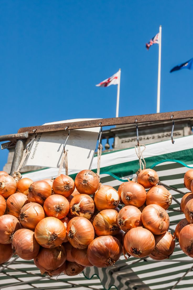 The flags flying high at the top of Ashton Town Hall from one of the market stalls, Tameside.