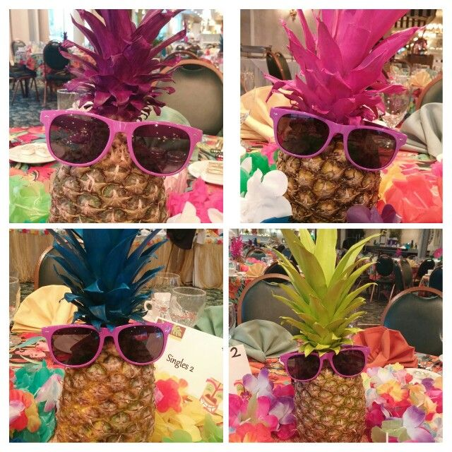 Luau centerpieces paint the crowns of a pineapple with