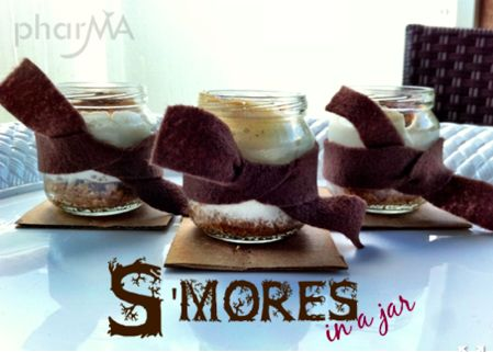 S'mores in a baby jar-S'mores in a jar ~ How yummy do these look?!  Plus, I love that they are already portion controlled – just the right size for this rich little dessert.  A crowd pleaser for grown-ups and kids alike.  The kids will have a blast layering the ingredients in a baby food jar and baking them in the oven – no campfire required.