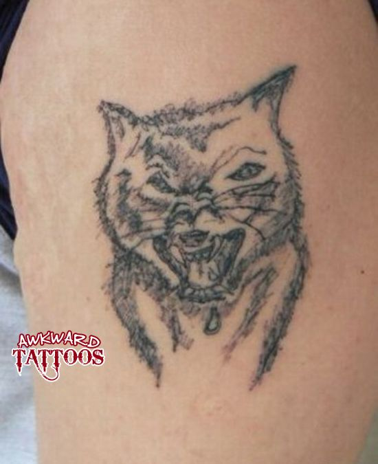Horrible wolf tattoo horrible tattoos pinterest for Bad cat tattoo