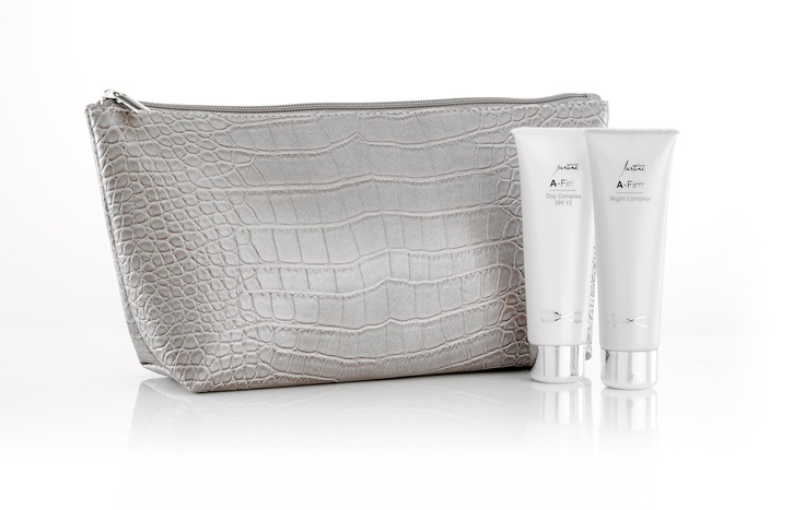 A-Firm Youth Enhancing Collection  Contains  •	Vanity Bag  Mock-croc PVC leather  22 cm L x 14 cm H x 8 cm W  •	A-Firm Day Complex SPF 15 50 ml  •	A-Firm Night Complex 50 ml  Code 3551  http://www.justine.co.za/PRSuite/home_page.page