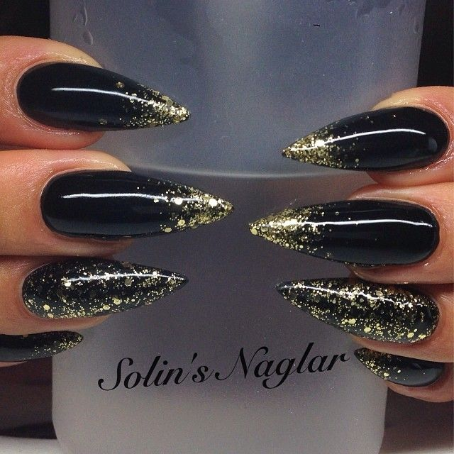 Black stilettos with gold glitter accents