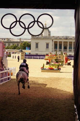 A great shot of an eventer galloping into the Olympic stadium at Greenwich Park in London. Can you imagine the rush these two must have in this moment?