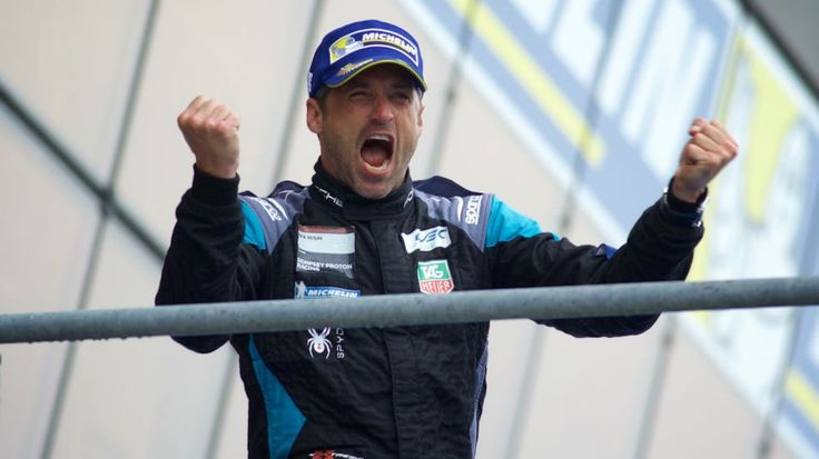 Patrick Dempsey celebrates on the podium after finishing 2nd in the 2015 running of the 24 Hours of Le Mans.