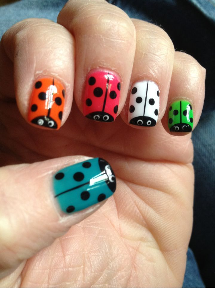 Ladybug Nails- Did this on my sister-in-law's nails and they turned out great! Used black and silver sparkles for the spots :D