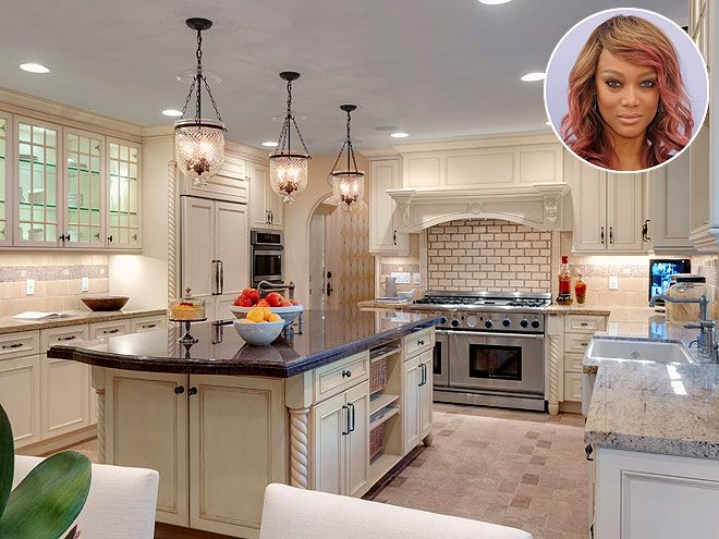 Look Inside These Gorgeous Celebrity Kitchens | TYRA BANKS | Prep for a dinner party would be a breeze in this (enormous) kitchen, that boasts stainless steel appliances, a deep sink, and a big island in the middle of Banks' Beverly Hills abode.