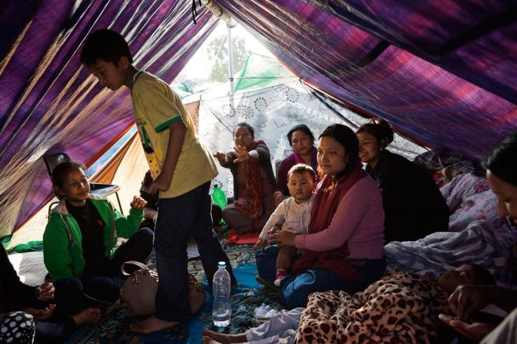 A displaced Nepalese family takes shelter in a tent in a Kathmandu park, April 27, 2015.