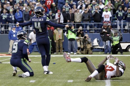 Seattle Seahawks' kicker Steven Hauschka (4) watches as his game-winning field goal is good in overtime as holder Jon Ryan watches the ball ...