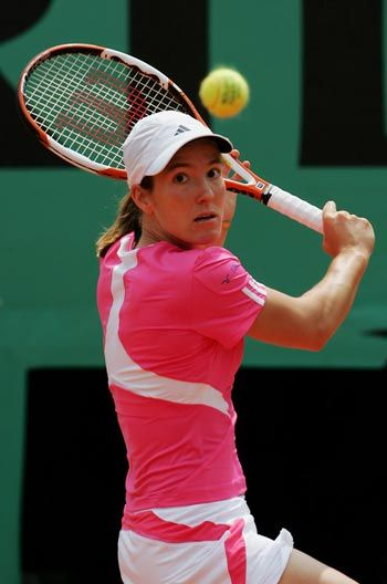 One of the all time greats Justine Henin of Belgium shown with her impeccable one-handed backhand.