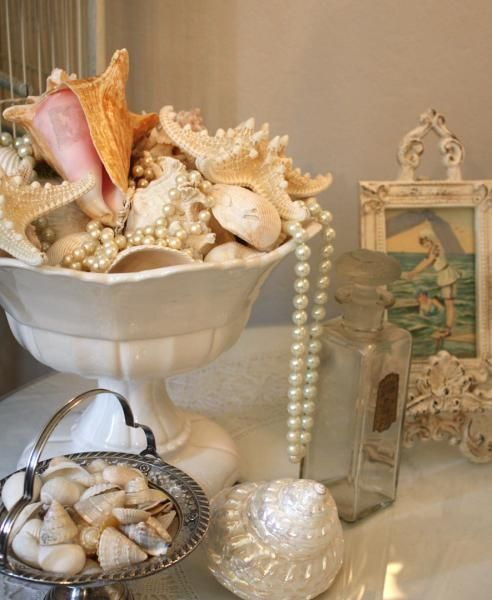 Shells...I have a bowl set up just like this!  Will add the strand of pearls, I also have, but didn't think to put them in the shell display like they have here.  Will fix that later today because I love what they add to the look :)