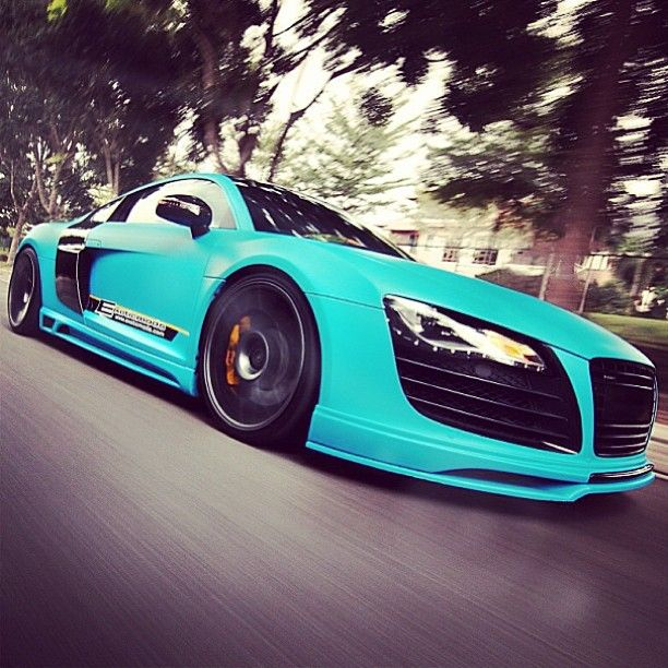 If I bought this ridiculously expensive car, I would absolutely choose this ridiculous color for it. Audi R8.